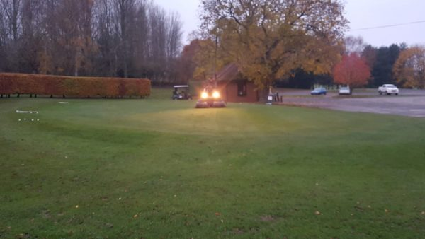 Putting green being cut at 7am