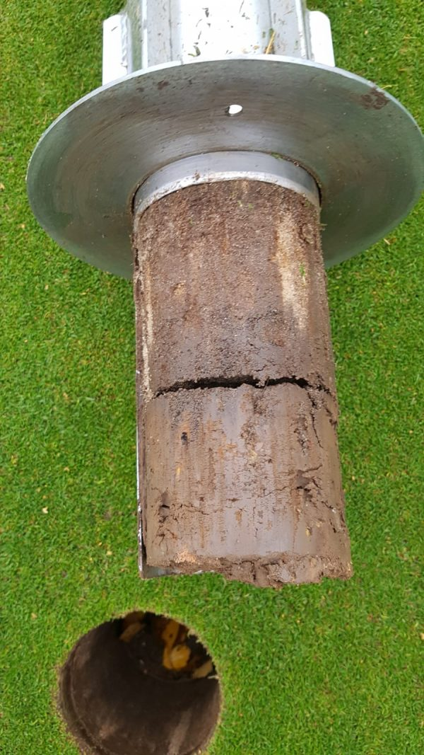8th green hole core showing sand filled hollow tines and clay bottom