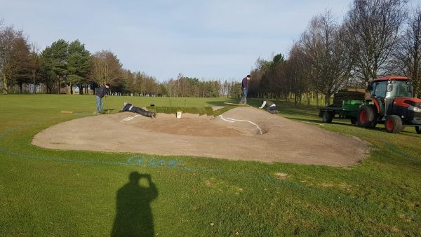 Neil,Sam,Chris ,Jake and Andy laying turf on the 17th fairway bunker